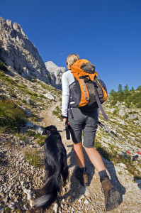 Woman Hiking with Dog