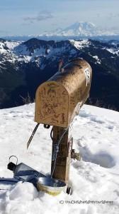 Mailbox Peak summit with Mount Rainier in the distance