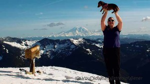 Girls holds Dachshund on the top of Mailbox Peak